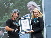 Stunt cyclist Andrei Burton is presented with a Guinness World Record certificate following his World Record he completed in the London Trials Championships, presented by Buxton, at this year's Prudential RideLondon FreeCycle 29/07/2017<br /> <br /> Photo: Tom Lovelock/Silverhub for Prudential RideLondon<br /> <br /> Prudential RideLondon is the world's greatest festival of cycling, involving 100,000+ cyclists – from Olympic champions to a free family fun ride - riding in events over closed roads in London and Surrey over the weekend of 28th to 30th July 2017. <br /> <br /> See www.PrudentialRideLondon.co.uk for more.<br /> <br /> For further information: media@londonmarathonevents.co.uk
