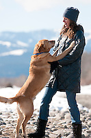 A young woman plays with her dog in Jackson Hole, Wyoming.