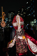 New York, NY - 31 October 2019. the annual Greenwich Village Halloween Parade along Manhattan's 6th Avenue. A man costumed as a pope with a death's head, complete with robes, papal ferula, and  mitre.