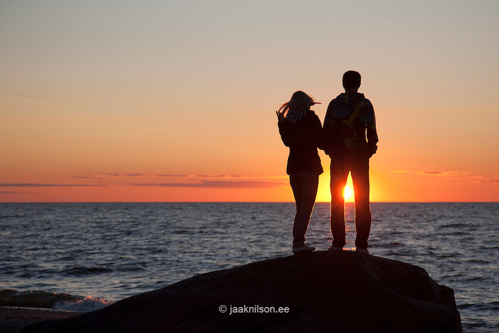 Couple Silhouette at Sunset on Beach