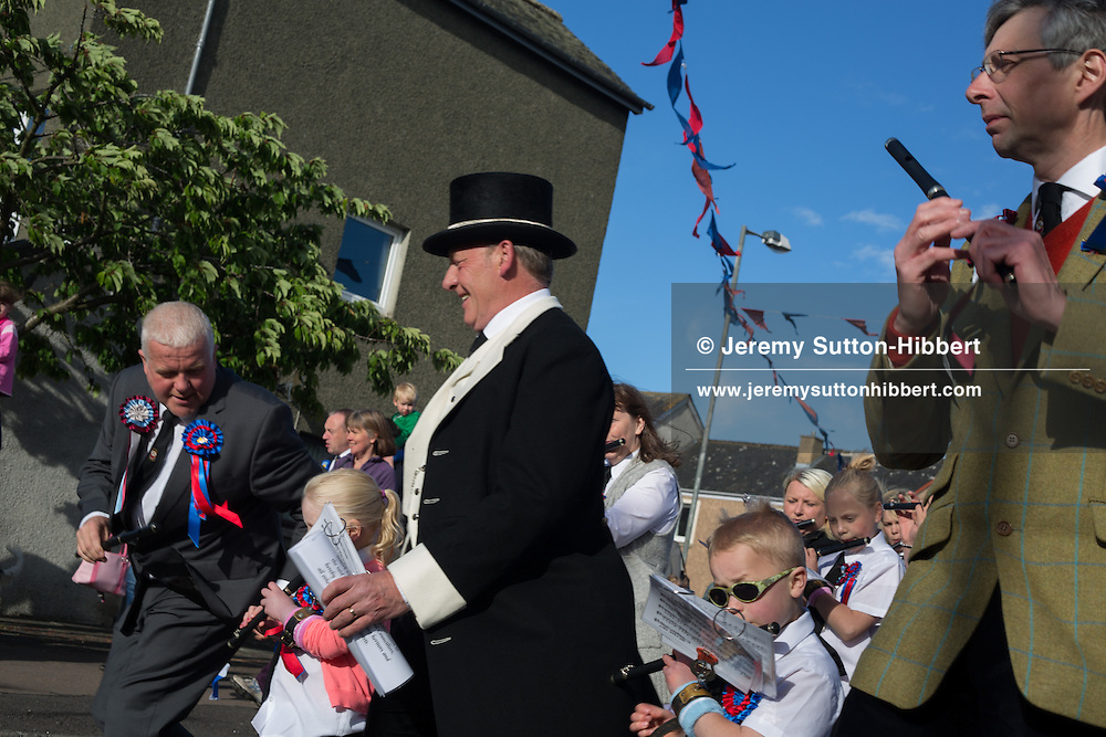 The Thursday evening 'Cryin' o' The Burley' event, where townsfolk walk around the town and the common riding is proclaimed by a town crier. The Common Riding festivities in Selkirk, with Royal Burgh Standard Bearer Martin Rodgerson, in Selkirk, Scotland, Thursday 13th June 2013. <br /> N55&deg;32.769'<br /> W2&deg;50.401'