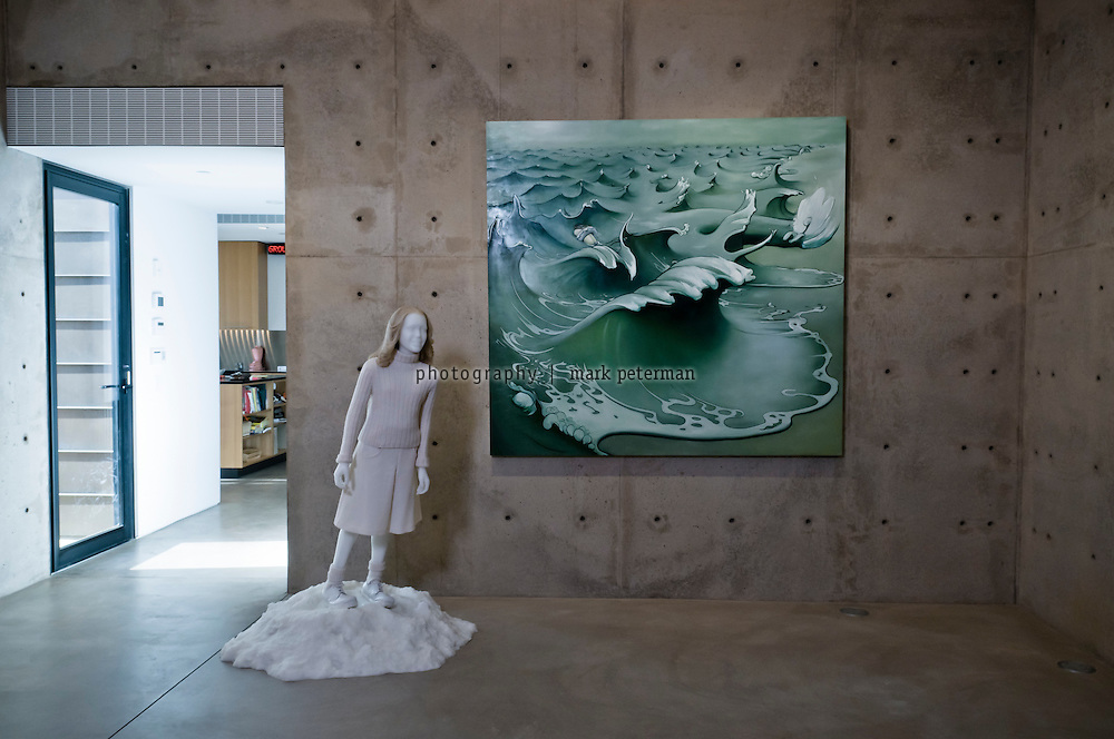 Scottsdale, AZ-Kent and VIcki Logan residence-03/03/11 Dark Gallery with Gray Wave by Inka Essenhigh on the wall and sculpture Jill Peters by Keith Edmier. Mark Peterman for The Wall Street Journal