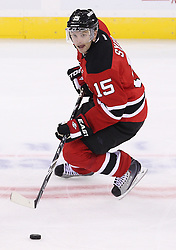 Oct 13; Newark, NJ, USA; New Jersey Devils right wing Petr Sykora (15) skates with the puck during the third period at the Prudential Center. The New Jersey Devils defeated the Los Angeles Kings 2-1 in an OT shootout.