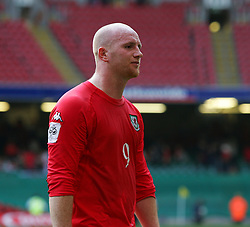 CARDIFF, WALES - SATURDAY MARCH 26th 2005: Wales' John Hartson walks off dejected after losing 2-0 to Austria during the Wold Cup Qualifying match at the Millennium Stadium. (Pic by David Rawcliffe/Propaganda)