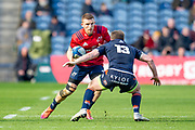 Andrew Conway (#15) of Munster Rugby looks to sidestep James Johnstone (#13) of Edinburgh Rugby during the Heineken Champions Cup quarter-final match between Edinburgh Rugby and Munster Rugby at BT Murrayfield Stadium, Edinburgh, Scotland on 30 March 2019.