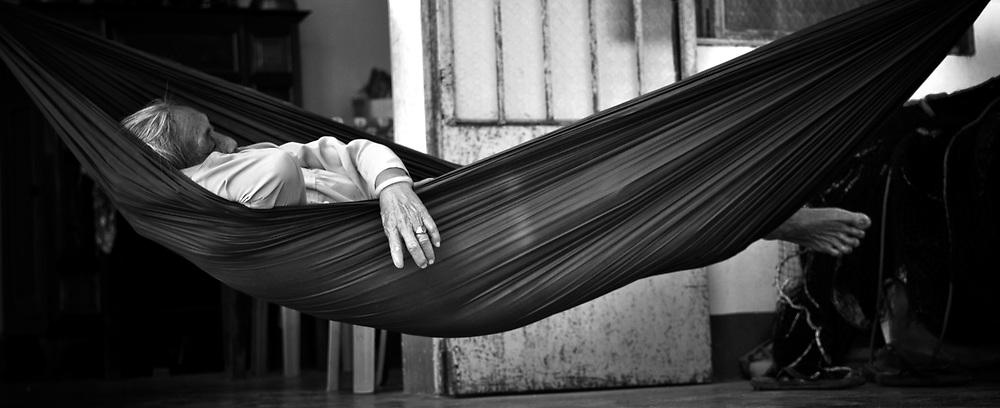 Old vietnamese woman sleeping in a hammock. Khanh Hoa province, Vietnam, Asia