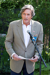 "© Licensed to London News Pictures. 19/05/2014. London, England. Pictured: Actor Nigel Havers reading war poems.  Show Garden ""No Man's Land: ABF The Soldiers' Charity Garden to mark the centenary of World War One.  Press Day at the RHS Chelsea Flower Show. On Tuesday, 20 May 2014 the flower show will open its doors to the public.  Photo credit: Bettina Strenske/LNP"