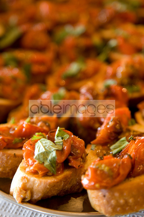 Close up of roasted tomatoes and basil crostini