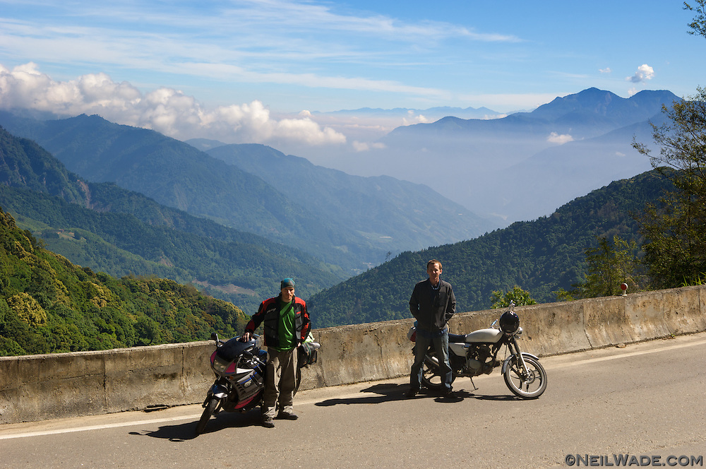 Two motorcyclists take a break on Ali Shan Mountain in Taiwan.