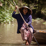 Lady Punting along the Mekong near Can Tho, Vietnam.<br />