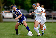 11 MAY 2012 -- ALTON, Ill. -- Civic Memorial High School soccer player Katelin Pinkterton (3) battles Alton Marquette High School's Kate Sanfilippo (13) for control of the ball during the Class 1A Regional Finals at Gordon Moore Park in Alton Friday, May 11, 2012. Photo © copyright 2012 Sid Hastings.