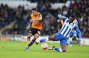 Hull City defender Isaac Hayden (20) shoots as Brighton central midfielder, Rohan Ince (24) closes down during the The FA Cup match between Hull City and Brighton and Hove Albion at the KC Stadium, Kingston upon Hull, England on 9 January 2016.
