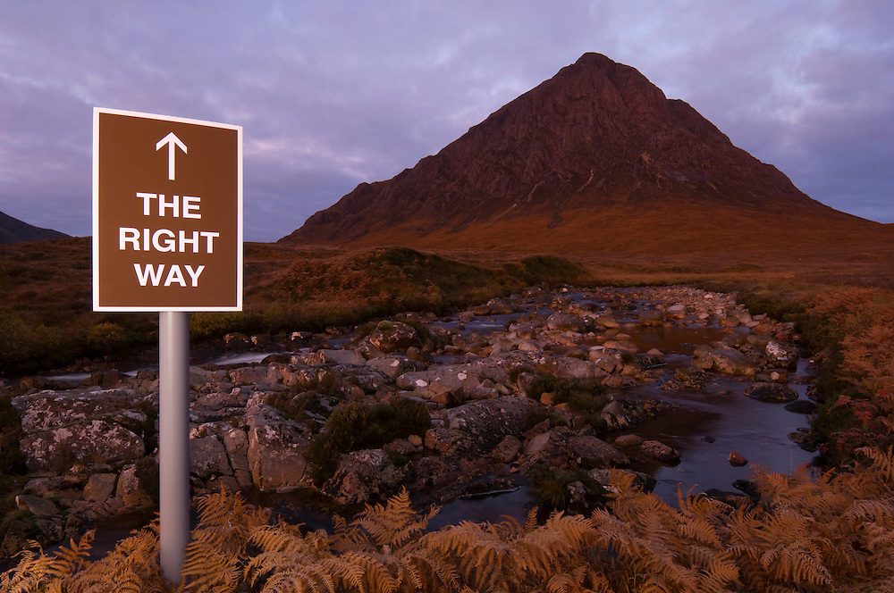 Spoof tourist sign  in front of  Buachaille Etive Mor, Scotland