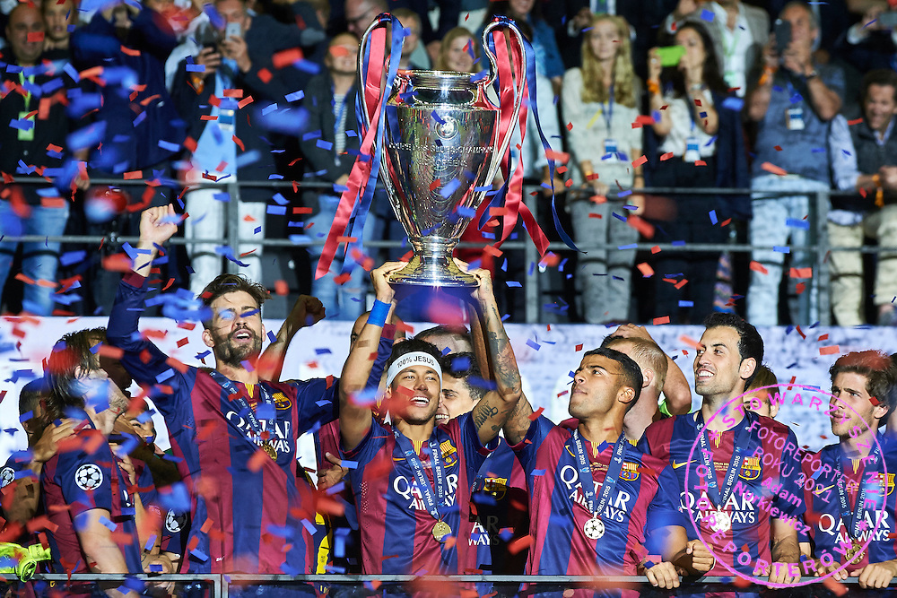 Neymar of FC Barcelona holds trophy while victory ceremony during the 2014/15 UEFA Champions League Final between Juventus and FC Barcelona at Olympiastadion on June 6, 2015 in Berlin, Germany.<br /> Germany, Berlin, June 6, 2015<br /> <br /> Picture also available in RAW (NEF) or TIFF format on special request.<br /> <br /> For editorial use only. Any commercial or promotional use requires permission.<br /> <br /> Adam Nurkiewicz declares that he has no rights to the image of people at the photographs of his authorship.<br /> <br /> Mandatory credit:<br /> Photo by &copy; Adam Nurkiewicz / Mediasport