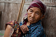 Old woman in hill tribe village, Thailand