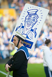 PORTSMOUTH, ENGLAND - Saturday, March 21, 2009: A navel teamed Portsmouth mascot carries a 'Play Up Pompey' banner during the Premiership match at Fratton Park. (Photo by David Rawcliffe/Propaganda)