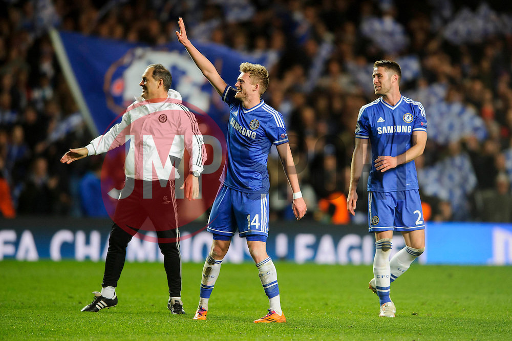 Chelsea Goalscorer Andre Schurrle (GER) celebrates at the final whistle after a dramatic 2-0 win to progress to the semi-final - Photo mandatory by-line: Rogan Thomson/JMP - 07966 386802 - 08/04/2014 - SPORT - FOOTBALL - Stamford Bridge, London - Chelsea v Paris Saint-Germain - UEFA Champions League Quarter-Final Second Leg.