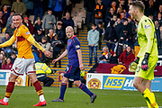 Steven Naismith of Hearts, Tom Aldred of Motherwell ans keeper Mark Gillespie of Motherwell all have a smile during the Ladbrokes Scottish Premiership match between Motherwell and Heart of Midlothian at Fir Park, Motherwell, Scotland on 17 February 2019.