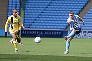 Coventry City midfielder John Fleck (7)  with a shot during the Sky Bet League 1 match between Coventry City and Millwall at the Ricoh Arena, Coventry, England on 16 April 2016. Photo by Simon Davies.