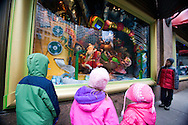 "Children look at the ""Naughty or Nice"" Christmas window display at Macy's department store taken in New York city December 21, 2007"