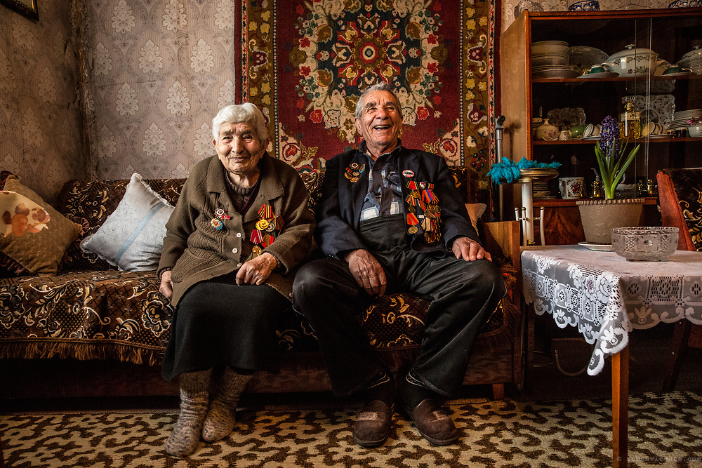 Andre and Vardanush sharing stories from World War II at their home. Gyumri, Armenia