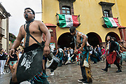 Aztec Indians dance in a procession through the Jardin Allende during the week long fiesta of the patron saint Saint Michael September 24, 2017 in San Miguel de Allende, Mexico.
