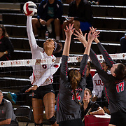 09 November 2017:  The San Diego State Aztecs women's volleyball team hosts UNLV Thursday night at Peterson Gym. San Diego State outside hitter Ashlynn Dunbar (6) spikes the ball past two UNLV defenders. The Aztecs won 3-1 (25-18; 16-25; 25-12; 25-13).<br /> www.sdsuaztecphotos.com