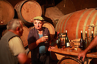 Domaine du Vissoux, Beaujolais..local workers take a pause amongst the barrels in the cellar... September 16, 2007..Photo by Owen Franken for the NY Times. - Photograph by Owen Franken