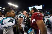January 24, 2016: Carolina Panthers vs Arizona Cardinals. Luke Kuechly and Larry Fitzgerald