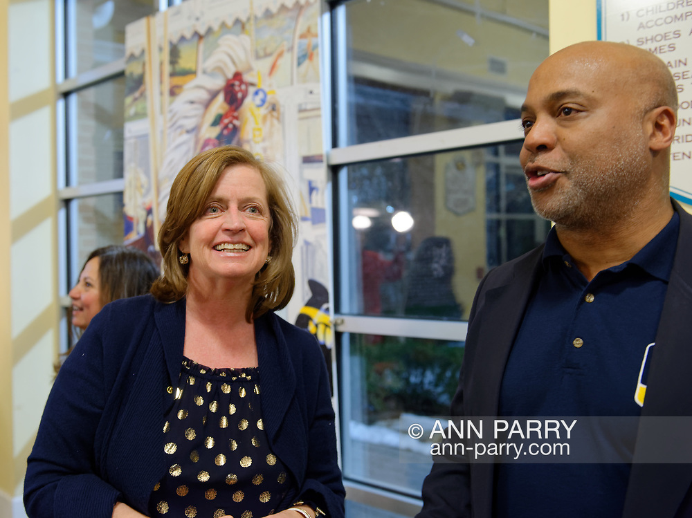 Garden City, New York, USA. March 9, 2019. New York State Assemblywoman JUDY GRIFFIN (District 21) and Baldwin Civic Association President DARIEN WARD chat with mural by artist Michael White behind them during mural Unveiling Ceremony. Event was held at historic Nunley's Carousel in its Pavilion on Museum Row on Long Island.