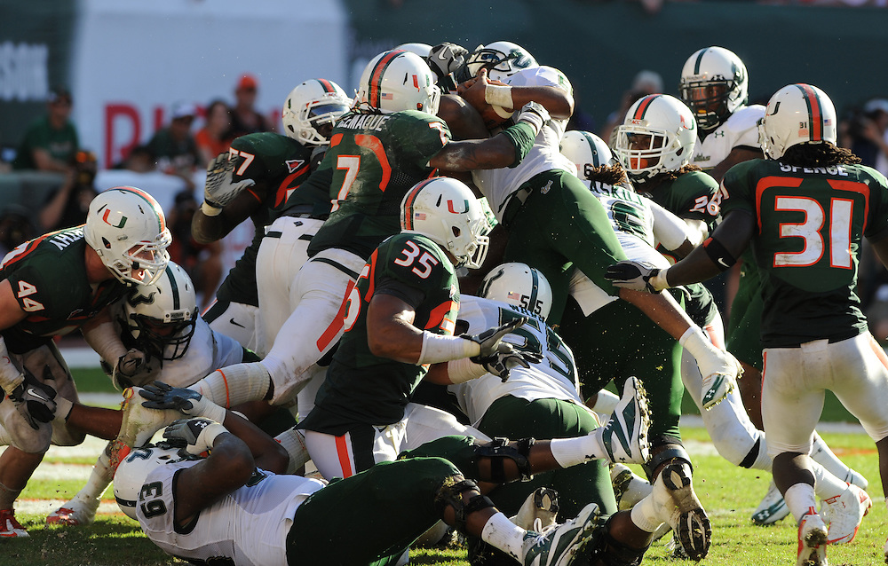 MIAMI GARDENS, FL - NOVEMBER 27: Demetris Murray #21 of the South Florida Bulls scores the game winning touchdown in overtime during the game against the Miami Hurricanes at Sun Life Stadium in Miami Gardens, Florida on November 27, 2010. South Florida defeated the Hurricanes 23-20.