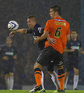 Picture by David Horn/Focus Images Ltd +44 7545 970036<br /> 13/09/2013<br /> Freddy Eastwood of Southend United and Niall Canavan of Scunthorpe United during the Sky Bet League 2 match at Roots Hall, Southend.