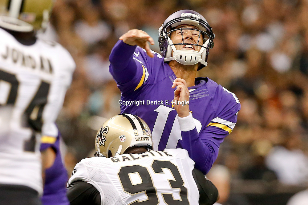 Sep 21, 2014; New Orleans, LA, USA; Minnesota Vikings quarterback Matt Cassel (16) is hit as he throws by New Orleans Saints outside linebacker Junior Galette (93) during the first quarter of a game at Mercedes-Benz Superdome. Mandatory Credit: Derick E. Hingle-USA TODAY Sports