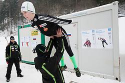Matjaz Triplat, Primoz Peterka and Katja Pozun during Normal Hill Individual Competition at FIS World Cup Ski jumping Ladies Ljubno 2012, on February 11, 2012 in Ljubno ob Savinji, Slovenia. (Photo By Vid Ponikvar / Sportida.com)
