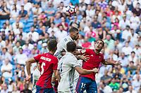 Real Madrid's Sergio Ramos and Club Atletico Osasuna's Unai Garcia during the match of La Liga between Real Madrid and Club Atletico Osasuna at Santiago Bernabeu Estadium in Madrid. September 10, 2016. (ALTERPHOTOS/Rodrigo Jimenez)