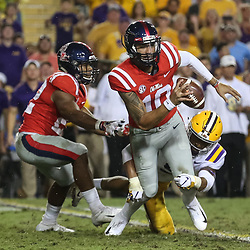 Sep 29, 2018; Baton Rouge, LA, USA; LSU Tigers safety Grant Delpit (9) sacks Mississippi Rebels quarterback Jordan Ta'amu (10) during the first quarter of a game at Tiger Stadium. Mandatory Credit: Derick E. Hingle-USA TODAY Sports