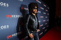 """Lenny Kravitz releases a photo on Twitter with the following caption: """""""".@CNNHeroes #HereToLove #RaiseVibration"""""""". Photo Credit: Twitter *** No USA Distribution *** For Editorial Use Only *** Not to be Published in Books or Photo Books ***  Please note: Fees charged by the agency are for the agency's services only, and do not, nor are they intended to, convey to the user any ownership of Copyright or License in the material. The agency does not claim any ownership including but not limited to Copyright or License in the attached material. By publishing this material you expressly agree to indemnify and to hold the agency and its directors, shareholders and employees harmless from any loss, claims, damages, demands, expenses (including legal fees), or any causes of action or allegation against the agency arising out of or connected in any way with publication of the material."""