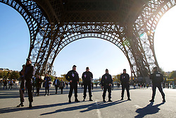 © Licensed to London News Pictures. 15/11/2015. Paris, France. French armed police patrolling the Eiffel Tower in Paris, France following the Paris terror attacks on Sunday, 15 November 2015. Photo credit: Tolga Akmen/LNP