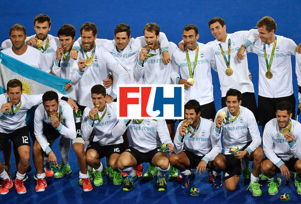 Argentina's players pose with their gold medals during the men's field hockey medals ceremony of the Rio 2016 Olympics Games at the Olympic Hockey Centre in Rio de Janeiro on August 18, 2016. / AFP / MANAN VATSYAYANA        (Photo credit should read MANAN VATSYAYANA/AFP/Getty Images)