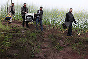 "ZHANGZHOU, CHINA - (CHINA OUT) <br /> <br /> ""Movie Theater"" In Rural China <br /> <br /> Movie projectionists carrying a set of screening facilities arrive at Xiaba village in Chongqing, China. There are many movie projectionists working in rural areas to show movies for farmers. <br /> ©Exclusivepix"