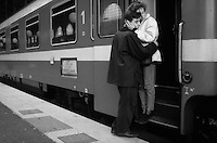 couple saying goodbye at a train station