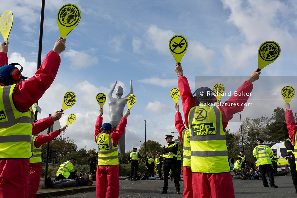 Environmental activist protest about Climate Change during the occupation of City Airport (London's Business Travel hub) in east London, the fourth day of a two-week prolonged worldwide protest by members of Extinction Rebellion, on 10th October 2019, in London, England.