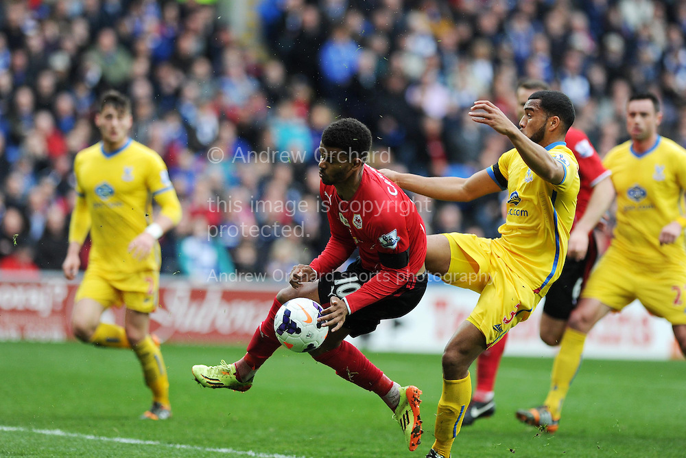 Fraizer Campbell of Cardiff city is fouled by Adrian Mariappa of Crystal Palace (r). Barclays Premier league match, Cardiff city v Crystal Palace at the Cardiff city stadium in Cardiff, South Wales on Saturday 5th April 2014.<br /> pic by Andrew Orchard, Andrew Orchard sports photography.