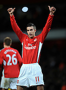 Robin Van Persie celebrates scoring the 4th goal during the FA Cup 4th Round Replay between Arsenal and Cardiff City at the Emirates Stadium on February 16, 2009 in London, England.