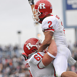 Oct 31, 2009; East Hartford, CT, USA; Rutgers wide receiver Tim Brown (2) celebrates his touchdown catch by being lifted into the air by Rutgers center Ryan Blaszczyk (61) during first half Big East NCAA football action between Rutgers and Connecticut at Rentschler Field.