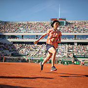 PARIS, FRANCE May 31. A ball girl in action during the  Rafael Nadal of Spain match against David Goffin of Belgium during the Men's Singles third round match on Court Philippe-Chatrier at the 2019 French Open Tennis Tournament at Roland Garros on May 31st 2019 in Paris, France. (Photo by Tim Clayton/Corbis via Getty Images)
