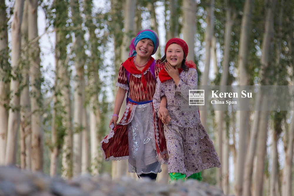 Uighur children in front of poplar trees, Hotan, Xinjiang, China