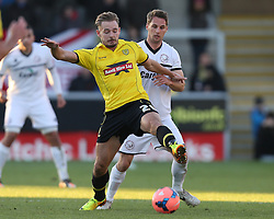Burton Albion's Adam McGurk battles with Hereford United's Rob Purdie - Photo mandatory by-line: Matt Bunn/JMP - Tel: Mobile: 07966 386802 10/11/2013 - SPORT - FOOTBALL - Pirelli Stadium - Burton upon Trent - Burton Albion v Hereford United - FA Cup