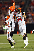 Cleveland Browns defensive end Carl Nassib (94) leaps in the air and celebrates with Cleveland Browns rookie linebacker Jabrill Peppers (22) after recovering a second quarter fumble at the New Orleans Saints 21 yard line during the 2017 NFL preseason football game against the New Orleans Saints, Thursday, Aug. 10, 2017 in Cleveland. The Browns won the game 20-14. (©Paul Anthony Spinelli)