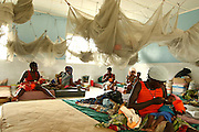 Women feed their children at the therapeutic feeding center of the Magbenthe hospital in Makeni, Sierra Leone on Thursday February 26, 2009. UNICEF sponsored some of the construction of the hospital facilities, and also provides high-protein biscuits and milk as part of a joint effort with the World Food Programme..